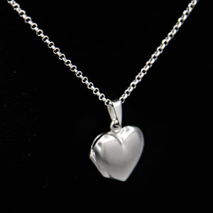 Silver heart shaped photo locket on Italian silver chain against black background