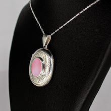 Load image into Gallery viewer, silver locket oval shaped with pink mother of pearl inset on a silver chain