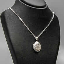 Load image into Gallery viewer, Embellished silver photo locket necklace with lily motif on Italian silver chain displayed on black bust.
