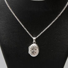 Load image into Gallery viewer, Oval shaped silver photo locket necklace on Italian silver chain, displayed on black bust.