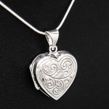 Load image into Gallery viewer, Silver shaped photo locket with embellishment on silver chain displayed on black