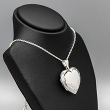 Load image into Gallery viewer, Large silver heart shaped photo locket on silver chain displayed on a black bust.
