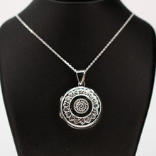 Load image into Gallery viewer, Large round silver photo locket pendant on a silver chain.