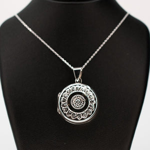 Large round silver photo locket pendant on a silver chain.
