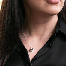 Load image into Gallery viewer, Model wearing black shirt and silver heart shaped photo locket on Italian silver chain.