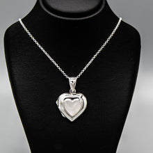 Load image into Gallery viewer, Silver heart shaped photo locket with white mother of pearl inset with a silver Italian chain displayed on a black bust.