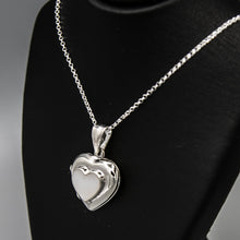 Load image into Gallery viewer, Silver heart shaped photo locket pendant with white mother of pearl inlay with a silver Italian chain displayed on a black bust.