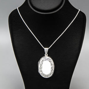 Large Oval shaped silver photo locket necklace on Italian silver chain, displayed on black bust.