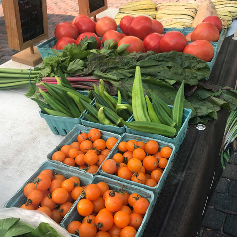 cherry tomatoes and okra at the farmers market