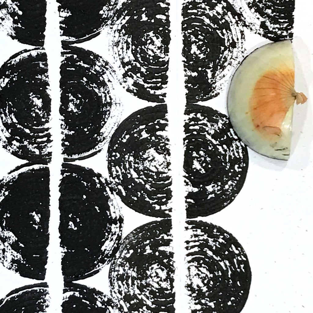 Betsy Marie print, onion pressing black ink on paper