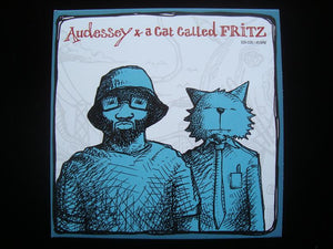 "Audessey & A Cat Called Fritz ‎– By Design / The Hop (7"")"