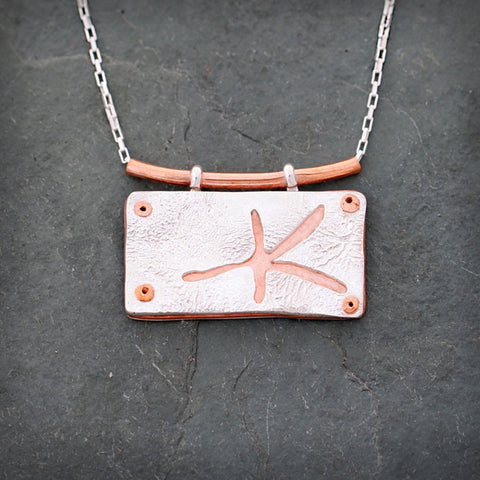 Sterling Silver and Copper Star Fish Necklace