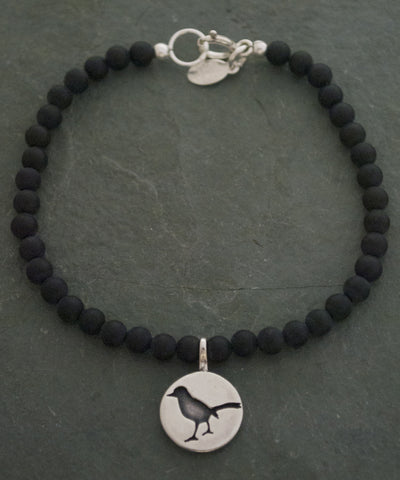 Sterling Silver and Matt Black Onyx Song Bird Bracelet