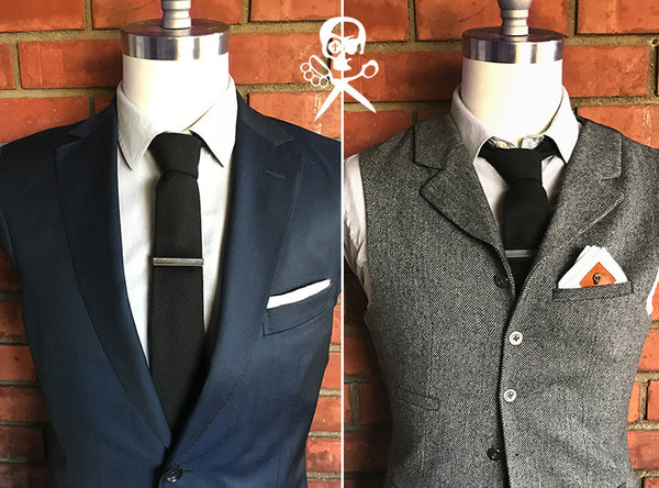 black tie and suit with tie clip and pocket square