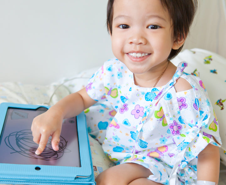 Girl in Hospital Playing with a Tablet