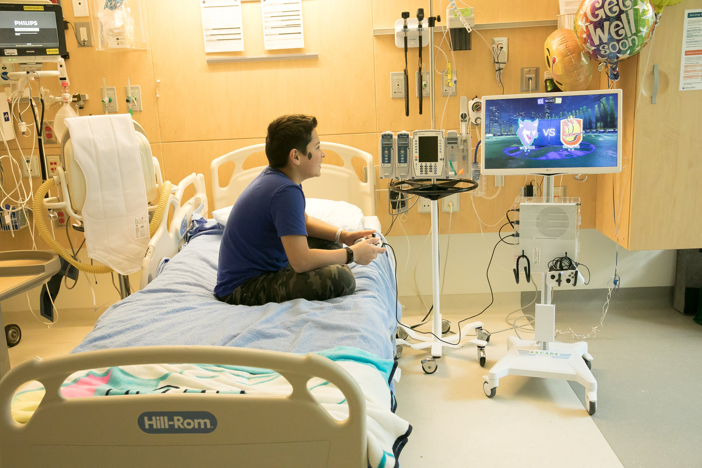 child playing mobile game cart in hospital