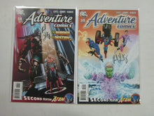 Load image into Gallery viewer, Adventure Comics (2010 2nd Series), SET:#518-519, 8.0/VF, SIGNED B4 : PNL LEVITZ