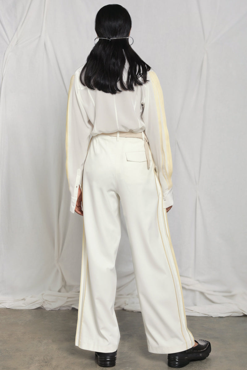 Wide-leg trousers with side pleats