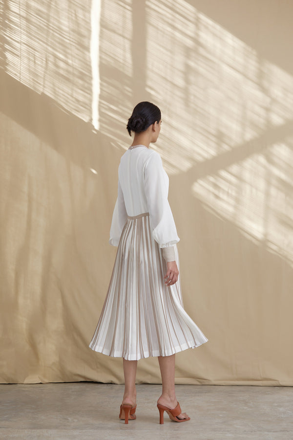 Silk dress with pleated skirt