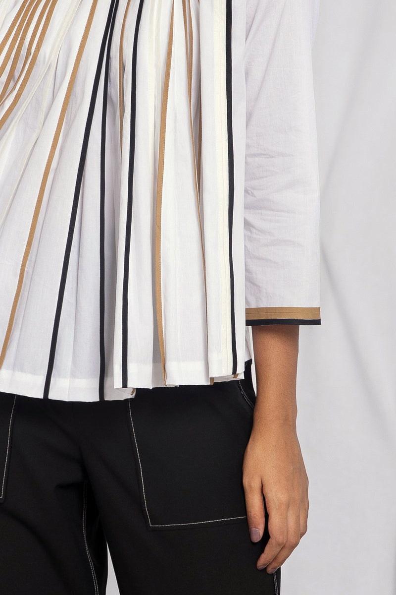 Pleated top with multi-colour binding