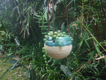 Load image into Gallery viewer, Tennis pot white clay Caribbean blue glaze. Picture showing tennis pot with string of peals succulent.
