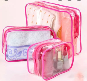 set of 3 pink transparent travel bags