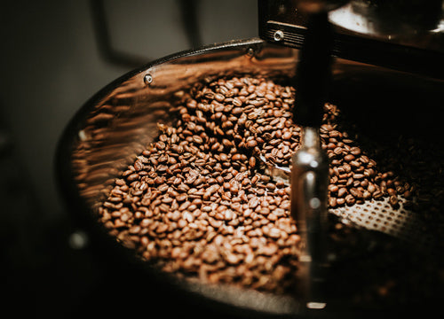 coffee beans being stirred