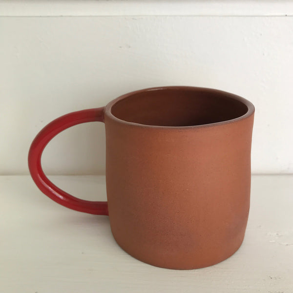 Terracotta mug with red glazed handle