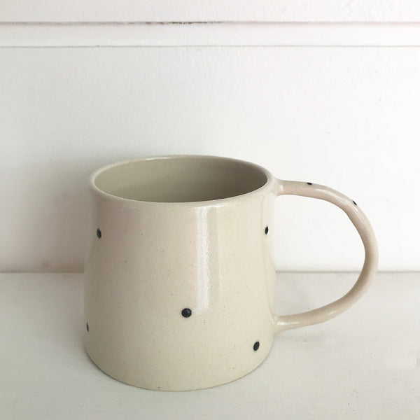 Hand thrown white ceramic mug decorated with little black spots