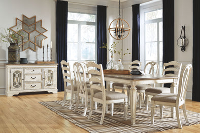 Realyn - 9 Pc. - Dining Room Set: Rectangular Table with Leaf, 4 Ladderback Side Chairs and 4 Ribbon Back Side Chairs