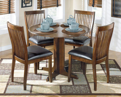 Stuman - Medium Brown - 5 Pc. - Round Drop Leaf Table & 4 UPH Side Chairs