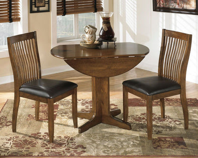 Stuman - Medium Brown - 3 Pc. - Round Drop Leaf Table & 2 UPH Side Chairs