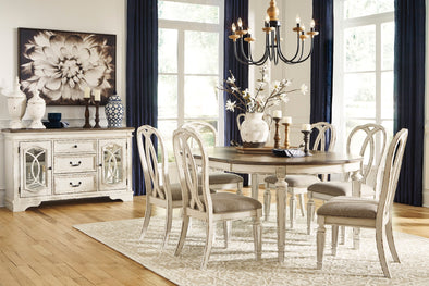 Realyn - Chipped White - 8 Pc. - Oval DRM EXT Table, 6 UPH Side Chairs & DRM Server
