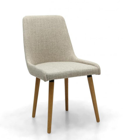 A Pair Of Capri Natural Upholstered Dining Chairs