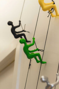 "6"" x 3"" x 3"" Resin Green Climbing Man"