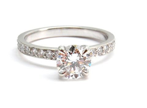 Brilliant Solitaire Inspired with side Diamonds.