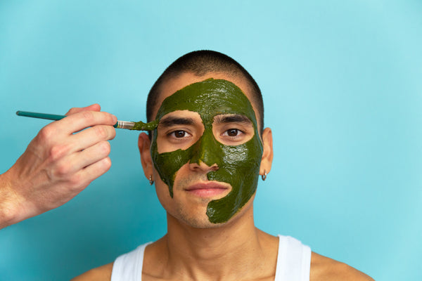 applying detox matcha face mask