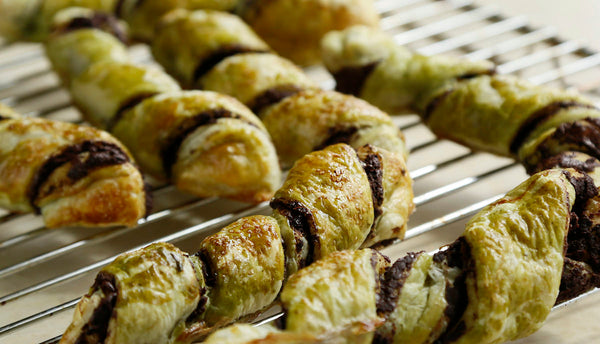 golden green baked matcha chocolate twists cooling down