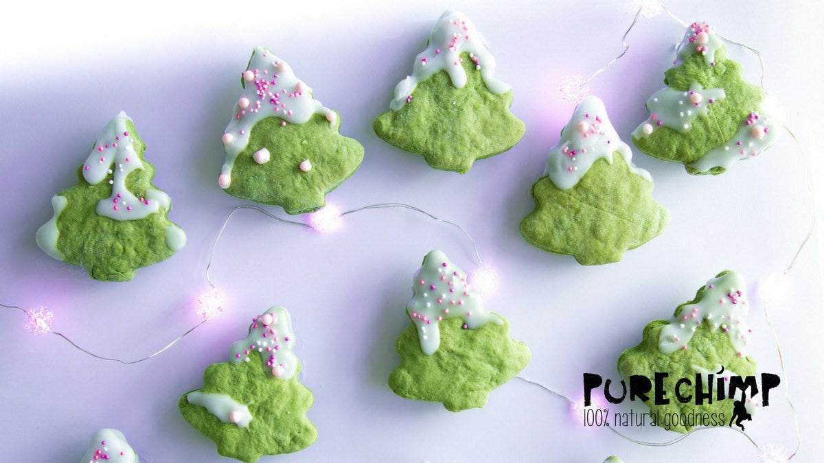 green matcha christmas cookies with white icing and lights