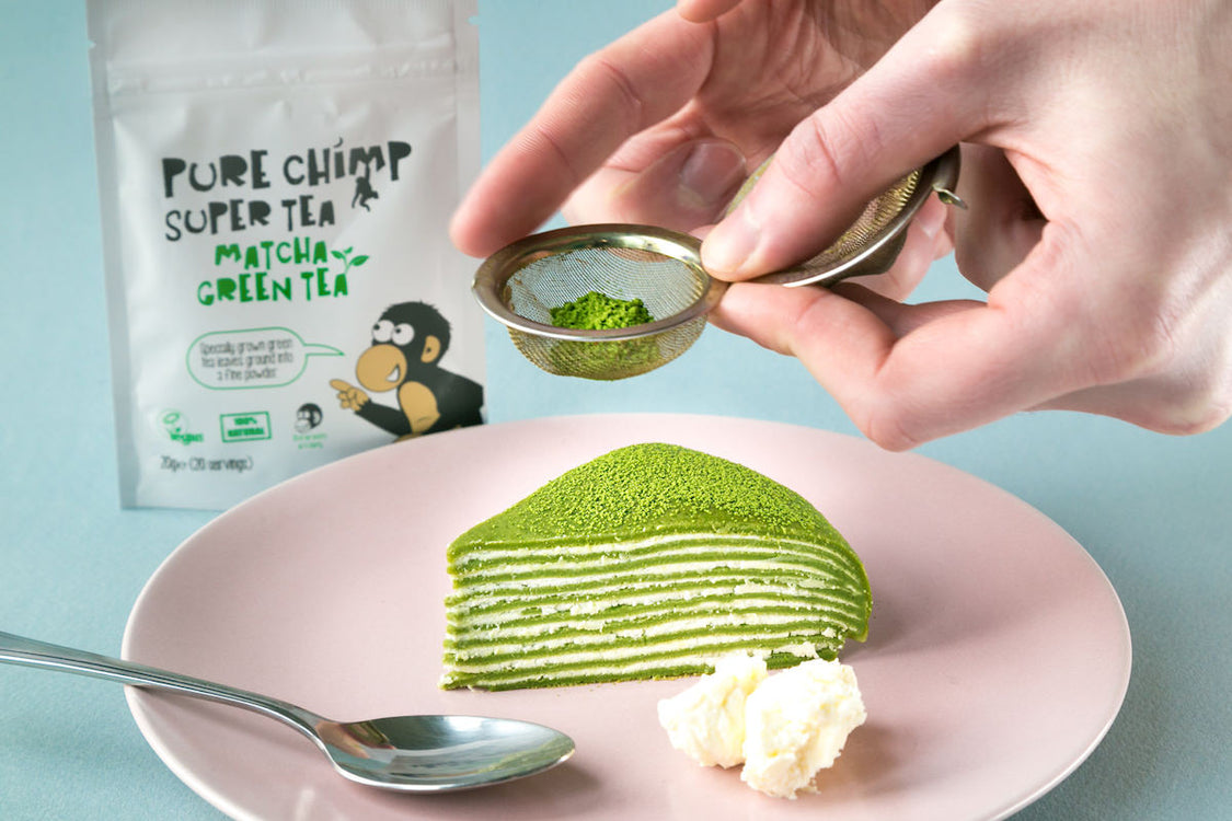matcha crepe cake with matcha sprinkled on top