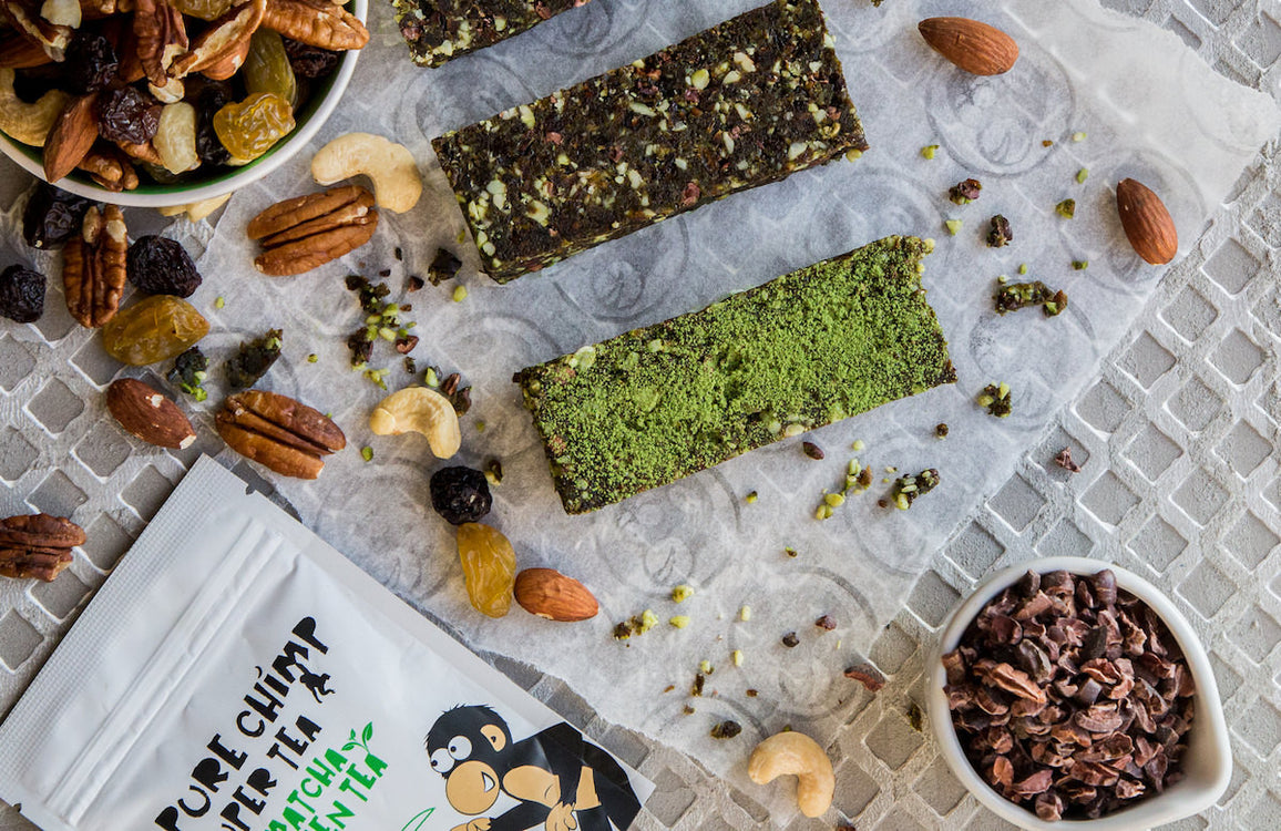matcha energy bars with nuts and raisins in the background