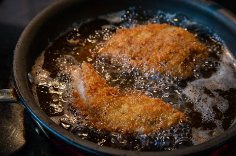 Grouse cutlets frying in pan
