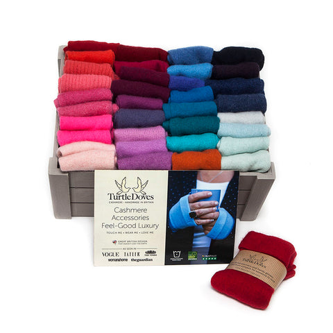 Turtle Doves Cashmere Fingerless Gloves in many different colours arranged in a box with promotional sign