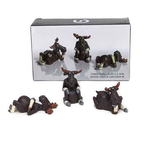 Three Small Elk character figures from Naasgransgarden reposing on front back and sitting