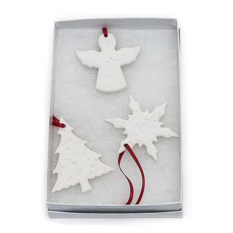 Angel Ceramics set of three embossed hanging Christmas decorations comprising an angel, Christmas tree and snowflake.