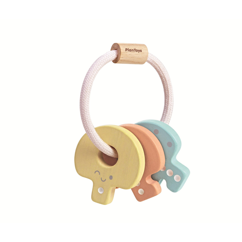 The Plan Toys Baby Key Rattle in A Touch of Pastel, enhancing baby's motor skills while they enjoy shaking them - these keys are easy for little hands to hold on.