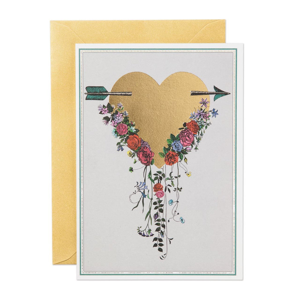 golden heart with an arrow, printed on the white card