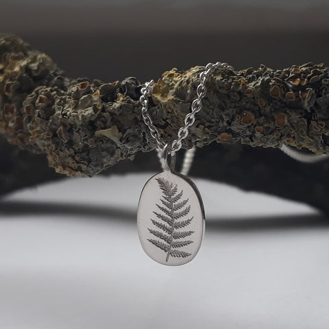 silver pendant with fern engraved motif by erin claus