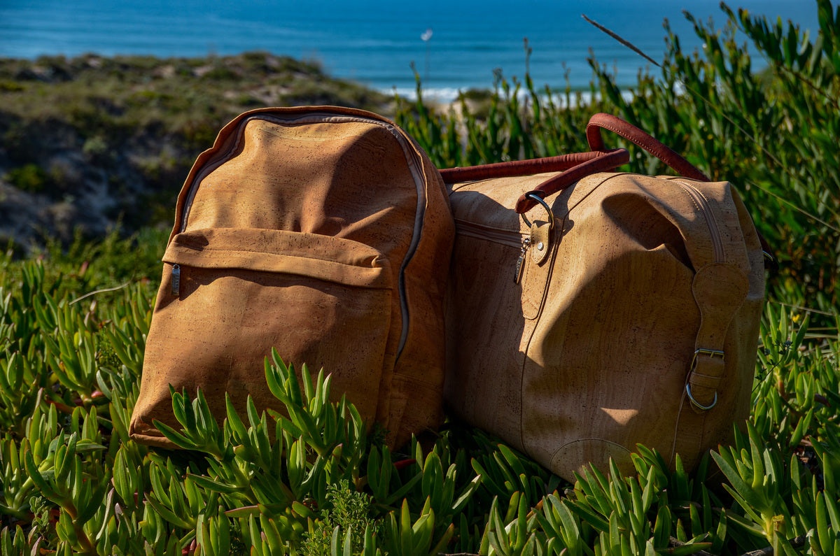 Natural Cork Backpack and Duffel Bag on Grass near the Beach