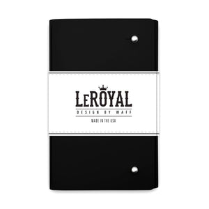 LeRoyal soft cover black journals from WAFF World Gifts Inc. is slick looking. with two metal dots holding the cover in place.
